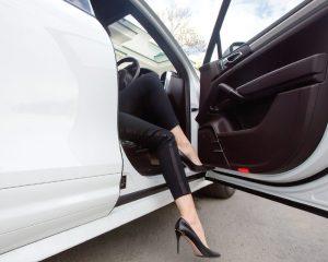 Female Passenger Exits Vehicle Driver Seat