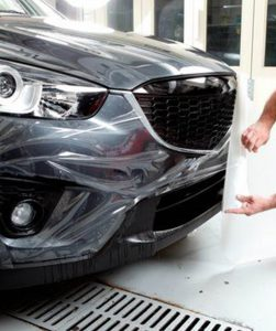 Cleargard Technician Applies Protective Film To Bumper