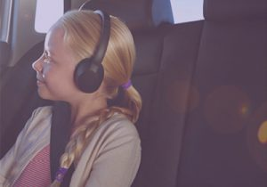 Child In Car With Headphones