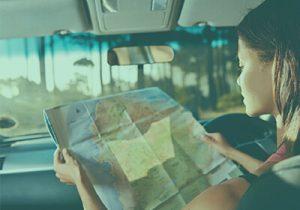 Driver Views Map To Navigate