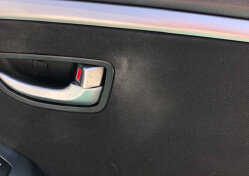 Car Door Interior With Sunscreen Stain Damage