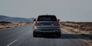 Silver Window Tint Protected SUV Rear Driving Through Desert