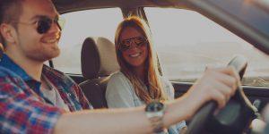 Smiling Passenger & Driver Enjoy Journey