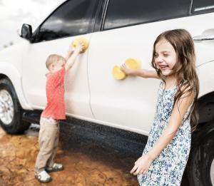 Children Playing While Washing Car
