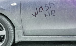 Dirty Car With 'Wash Me' Written In Dust