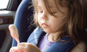 Child Eating Ice Cream In Car Interior